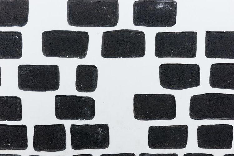 Full frame shot of computer keyboard on white wall