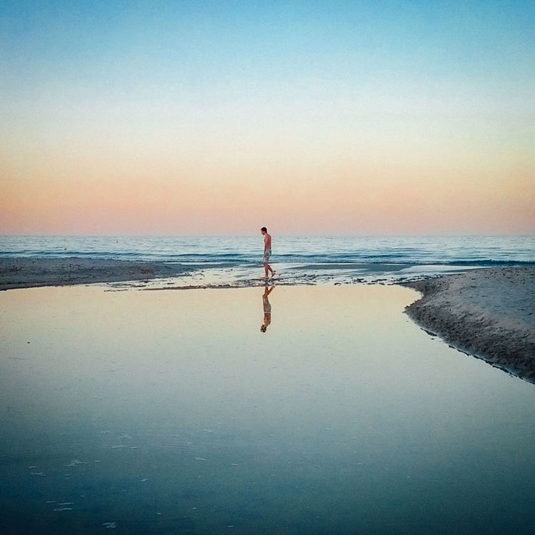Lonely Beach Boy Italia Italy Lonely Man Mare Nature Nightfall Reflection Reflections Sardegna Sardinia Sea Seascapes Siniscola  Sunset Tranquility People Of The Oceans Lost In The Landscape