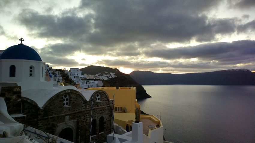 || Nature Theories || Sunrise at Santorini, Greece. Sunrise TheFoneFanatic Nokia  Nokia808 Vacations Mobilephotography PhonePhotography Nature Mountain Place Of Worship Dome Arch Sky Whitewashed Cross
