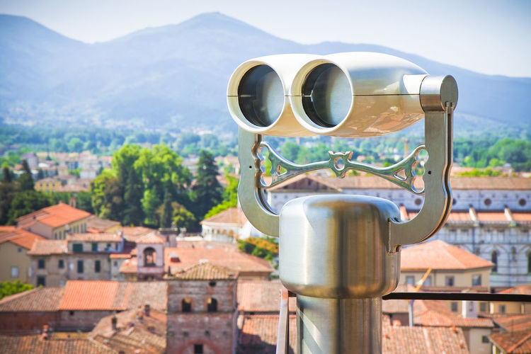 Medieaval italian city with binoculars on foregound Lucca Italy Architecture Binoculars Building Building Exterior Built Structure City Cityscape Coin Operated Coin-operated Binoculars Day Focus On Foreground Hand-held Telescope Italy Lucca City Mountain Mountain Range Nature No People Observation Point Outdoors Residential District Security Sky Travel Destinations