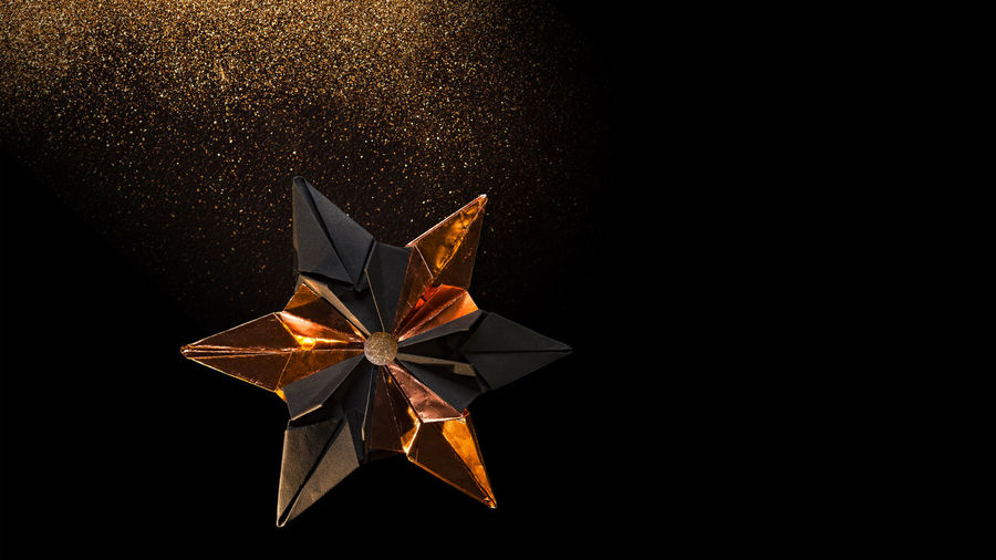 Star from black cardboard and bronze colored foil in front of black background 6 Prongs Advent Black Background Bronze Christmas Copy Space Glitter Black Cardboard Close Up Contrast Copper  Decoration Folded Folding Technique Gold Dust Matte Metal Foil Modern Colors Origami Paper Reflexions Star Studio Shot Trickle
