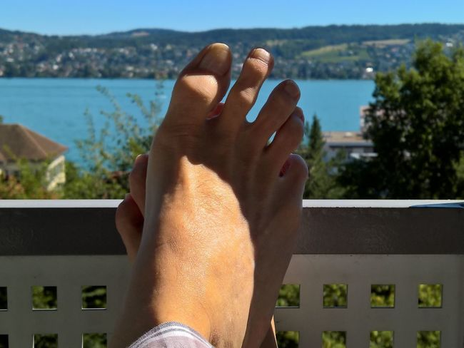 Beauty In Nature Blue Close-up Focus On Foreground Foot Human Foot Lake Of Zurich Lake View Leisure Activity Lifestyles Nature Part Of Person Personal Perspective Relax Relaxation Sky Sunlight Switzerland Unrecognizable Person View Water Zurich, Switzerland