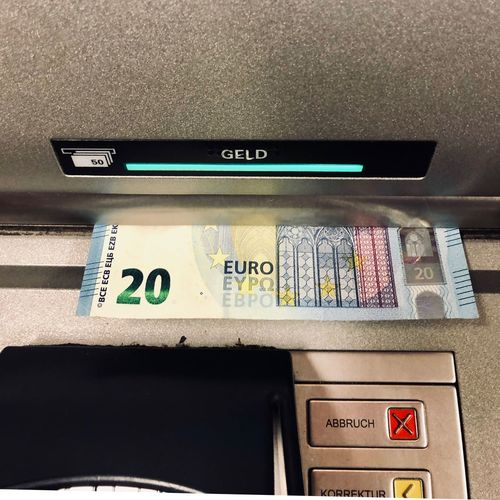 Close-up of euro currency at atm