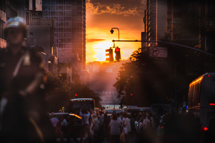 Manhattanhenge 2018 42nd Street Twice a year it happens. The setting sun is in line with the Manhattan street grid fro west to east. It's a breathtaking scene as the watchers look upon the setting sun. #manhattanhenge2018 #manhattanhenge #sunsettinglight #ronlouisfoster #ronlouisphotos #42ndstreet #newyorkcityhenge Manhattan Manhattanhenge Ronlouisphotos Ronlouisfoster 42ndStreet Newyorkcityhenge Manhattanhenge2018 Sunsettinglight Sunset Silhouettes New York City Manhattan Sunset Rays Of Sunshine Sunset Rays Orange Sunset Orange Sunset Rays Street Photography Sunset Roadway Policeman Mounted Police City Crowd The Street Photographer - 2018 EyeEm Awards