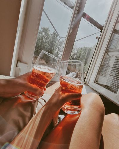 Cropped image of hand holding glass of beer