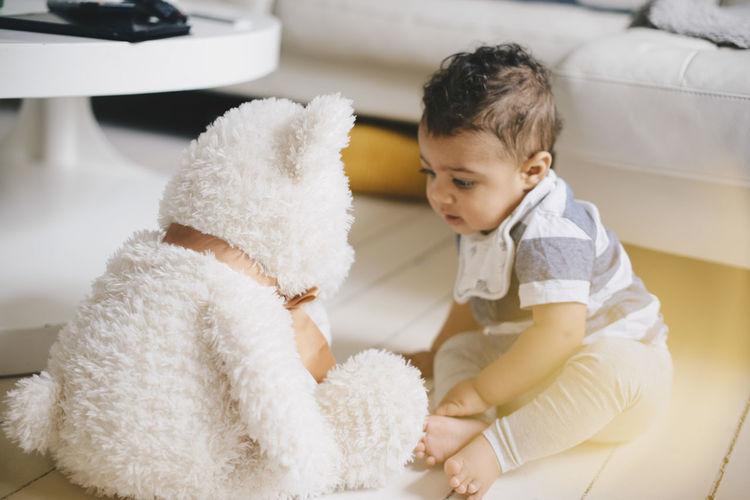 Cute boy sitting at home