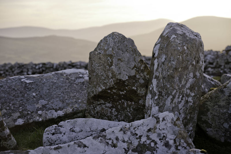 Close-up of rock against sky during winter