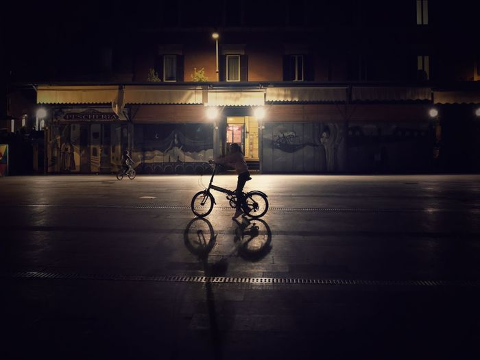 Stranger Things Atmospheric Childhood Night Streetphotography EyeEm Best Shots Illuminated Architecture Built Structure Transportation Mode Of Transportation Building Exterior Night City Bicycle Street Travel Outdoors Real People Adventures In The City