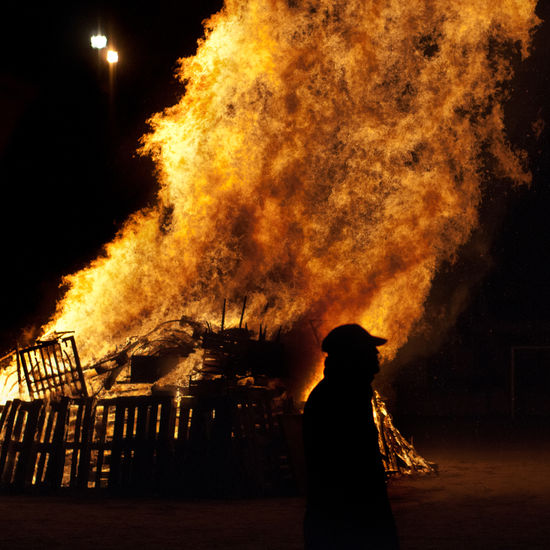 Accidents And Disasters Burning Destruction Firefighter Flame Heat - Temperature Men Night One Person Outdoors People Real People Silhouette Standing Analogue Sound
