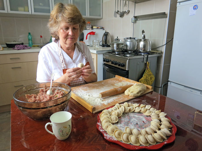 home made russian pilmeni Blond Hair Day Domestic Kitchen Dough Food Food And Drink Freshness Indoors  Kitchen Kneading Leisure Activity Lifestyles One Person People Preparation  Preparing Food Real People Senior Women Women The Portraitist - 2018 EyeEm Awards My Best Travel Photo 50 Ways Of Seeing: Gratitude My Best Photo