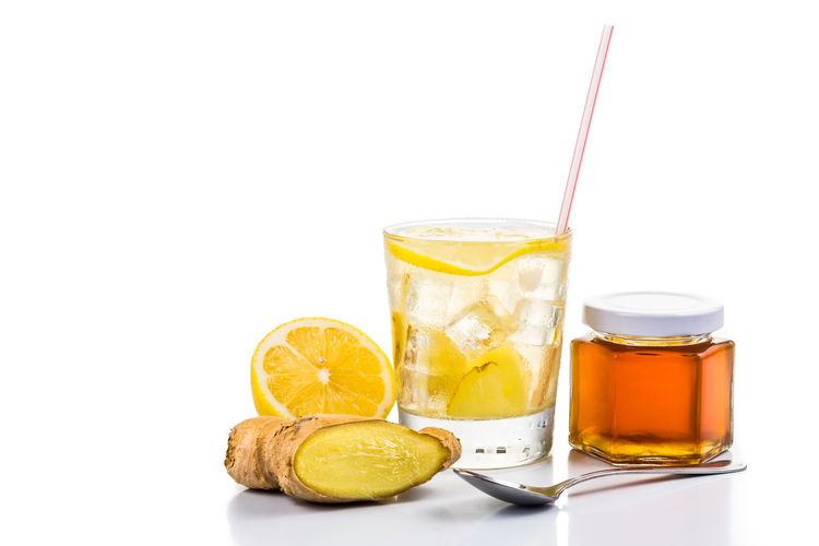 Cold icy refreshing and healthy ginger with raw organic honey drinks Ginger Tea Tea Citrus Fruit Drink Drinking Glass Drinking Straw Food Food And Drink Freshness Ginger Honey Indoors  Lemon No People Refreshing Refreshment SLICE Still Life Studio Shot White Background