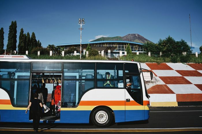 Airport Airport Bus ASIA Blue Sky Bus Clear Sky Colorful Day INDONESIA Land Vehicle Maluku  Mode Of Transport Moluccas People Ternate Transportation Traveling Let's Go. Together.