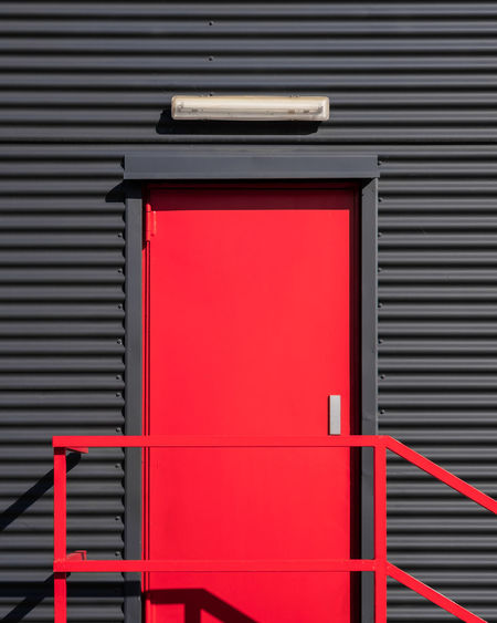 Red closed shutter of building