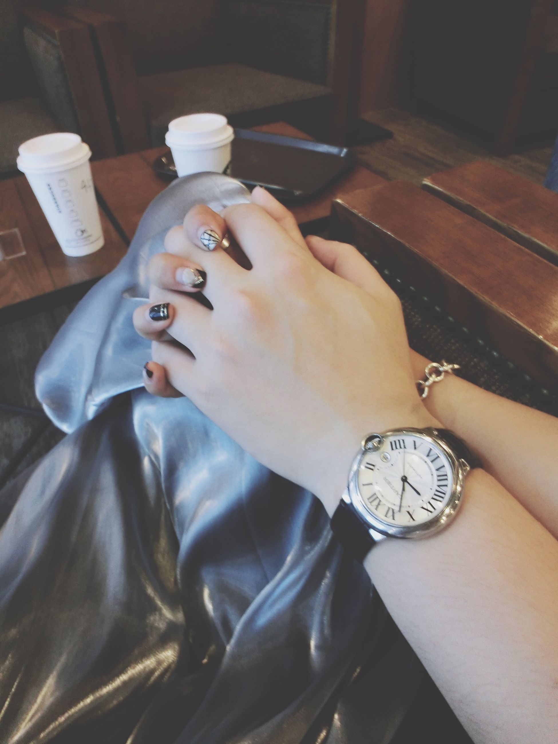 indoors, person, part of, holding, lifestyles, leisure activity, personal perspective, human finger, cropped, close-up, high angle view, unrecognizable person, table, home interior, men, wristwatch