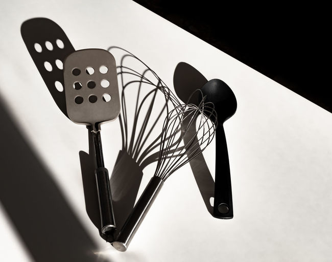 High angle view of kitchen utensils on table