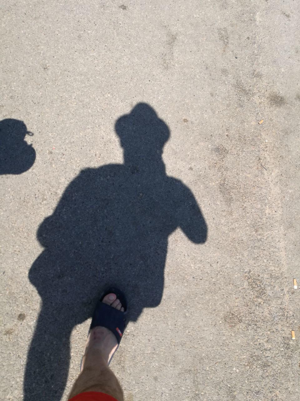 shadow, one person, sunlight, focus on shadow, one man only, holding, day, real people, outdoors, people, adults only, human body part, only men, lifestyles, human hand, adult, standing, low section, men