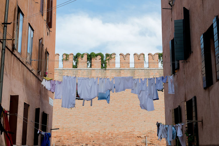 Clothes drying along buildings