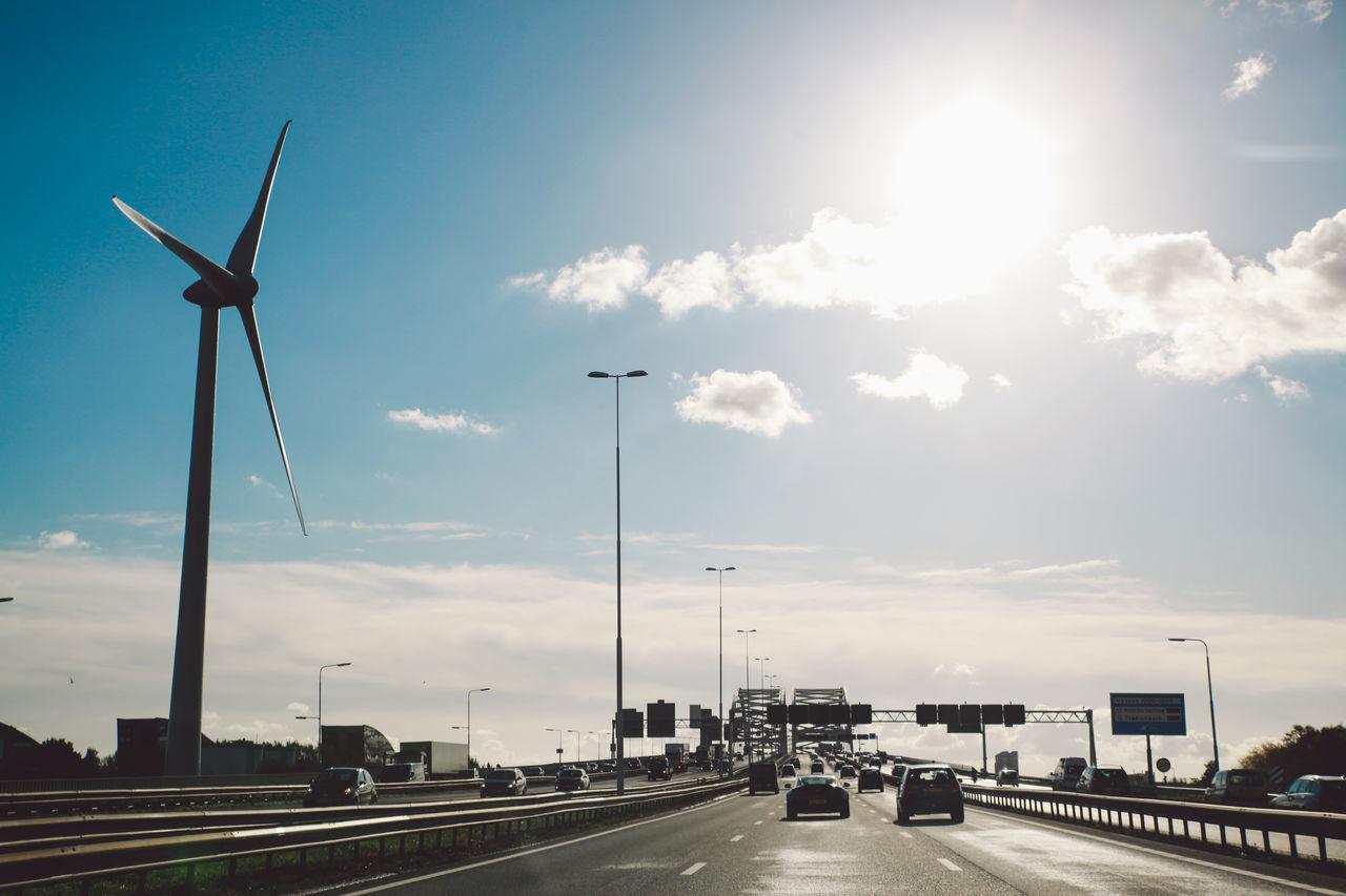 sky, transportation, cloud - sky, wind turbine, road, alternative energy, day, outdoors, wind power, architecture, no people