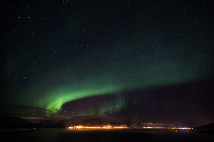 Scenic view of northern lights against star sky