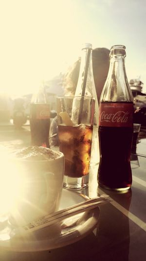 All I need. Coca-Cola, Label/logo/sign Coca Cola Coffee Coca-cola Drink Refreshment Sunlight Food And Drink Glass - Material Nature Glass Day Food Household Equipment Container Freshness Drinking Glass Lens Flare No People Table Close-up Indoors  Still Life Bottle