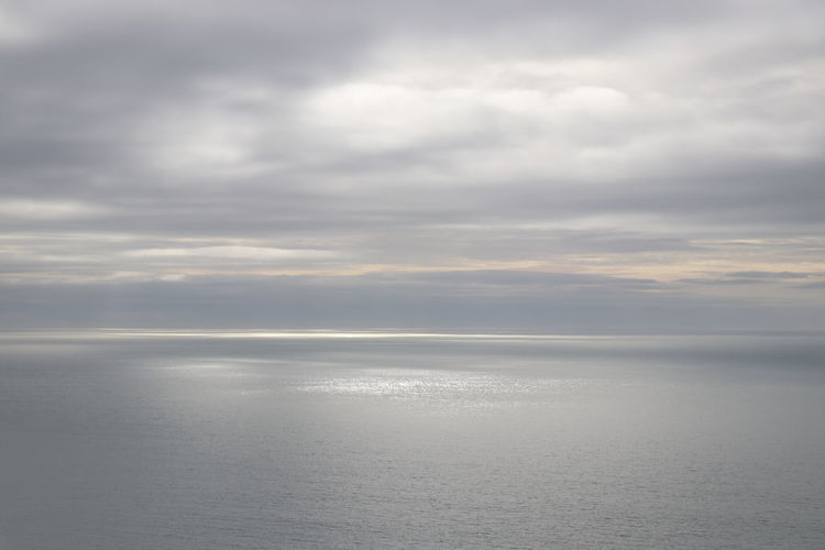 Sunlight on sea through clouds Beauty In Nature Cloud - Sky Day Horizon Horizon Over Water Idyllic Nature No People Outdoors Overcast Reflection Scenics - Nature Sea Sky Sunlight On Sea Sunlight Through Clouds Tranquil Scene Tranquility Water Waterfront First Eyeem Photo