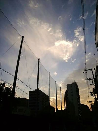 Clouds And Sky Urban Landscape Osaka 大阪 Japan Color Explosion Sunset Silhouettes Walking Home Street Photography Looking Up Urban Exploration Light And Shadow Nishinari Street Ultimate Japan The City Light