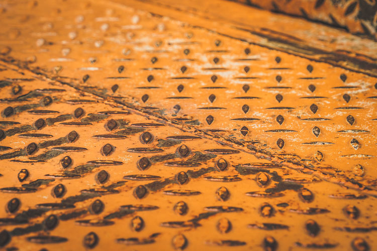 Abundance Backgrounds Black Color Brown Carpet - Decor Close-up Design Full Frame High Angle View Indoors  Metal No People Orange Color Pattern Repetition Selective Focus Table Textile Textured