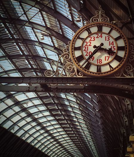 Low angle view of clock against ceiling at railroad station