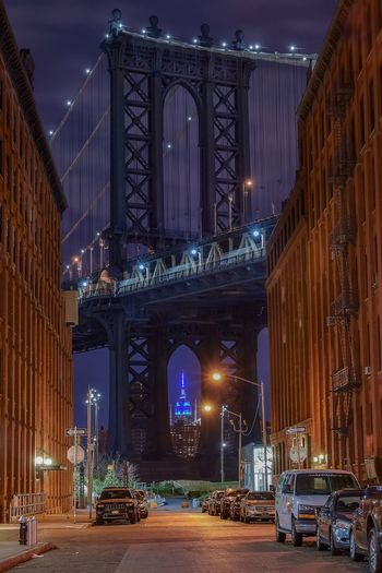 Low Angle View Of Illuminated Brooklyn Bridge Against Sky At Night