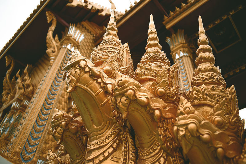 Belief Religion Spirituality Sculpture Building Built Structure Place Of Worship Art And Craft Architecture Statue No People Representation Craft Gold Colored Creativity Low Angle View Human Representation Building Exterior Ornate Carving Idol