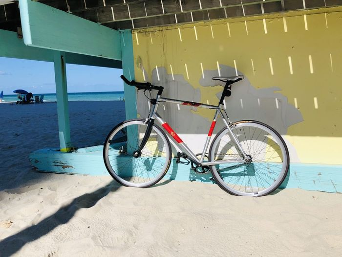 Bicycle parked on beach