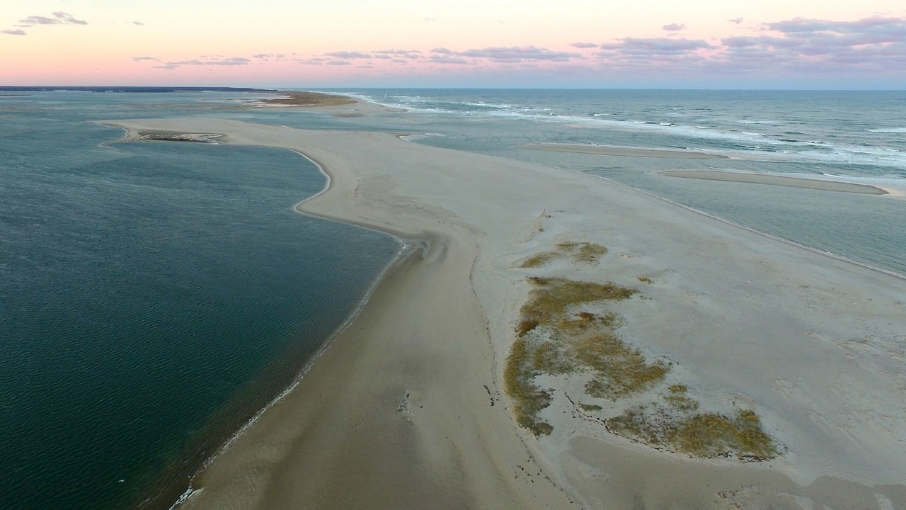 Aerial View Of Beach Against Sunset Sky