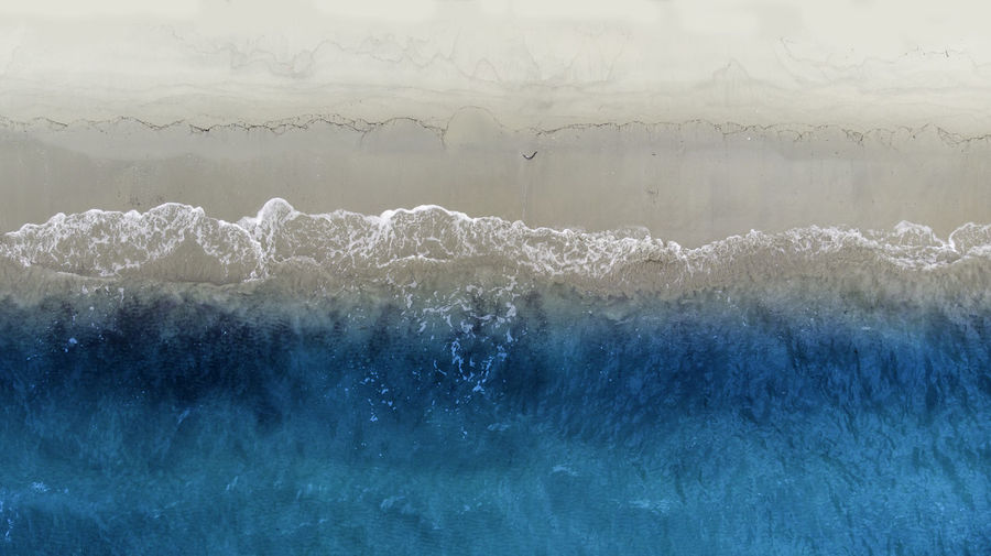 A beach Water No People Motion Beauty In Nature Nature Scenics - Nature Wave Power In Nature Sea Environment Frozen Power Cold Temperature Sky Ice Outdoors Blue Icicle Turquoise Colored Breaking Dji Drone  Beach Sand EyEmNewHere