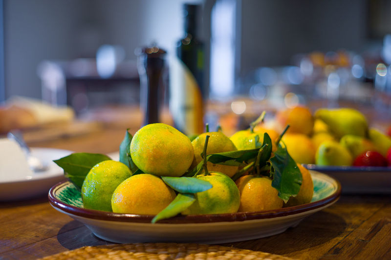 Bowl Citrus Fruit Close-up Continental Day Domestic Room Focus On Foreground Freshness Fruit Healthy Eating Indoors  IT Lemon Lime No People Orange Sicily SLICE Squeezing Table Travel Variation