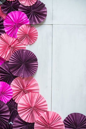 Close-up of multi colored umbrellas on wall