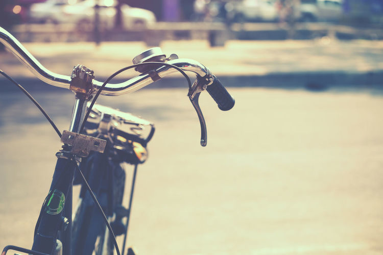 Detail of a Vintage Bicycle Handlebar Resting in the city Street (film look instagram effect) Focus On Foreground Bicycle Transportation Mode Of Transportation Metal Land Vehicle Day Handlebar No People Travel Outdoors City Sunlight Vintage Street Transportation Ride