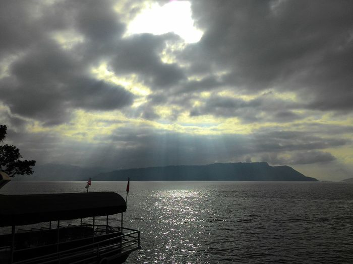 Toba Lake in the morning Lake Lakeview TOBALAKE EyeEm Nature Lover EyeEm Selects EyeEm Gallery Eye4photography  EyeEm Nature Lover EyeEmNewHere. EyeEmNewHerе Rays Of Light Ray Ray Of Light Rays Of Sunshine Nature Nature Photography Morning Relaxing Relax Time  Scenic View Scenics - Nature Sunlight Summer Sky Nature_collection Naturelovers Daily Daily Life Scenics Sun Sky And Clouds EyeEmNewHere Sea Tree Nautical Vessel Dramatic Sky Lightning Power In Nature Horizon Over Water Moody Sky Romantic Sky Calm Atmospheric Mood A New Beginning