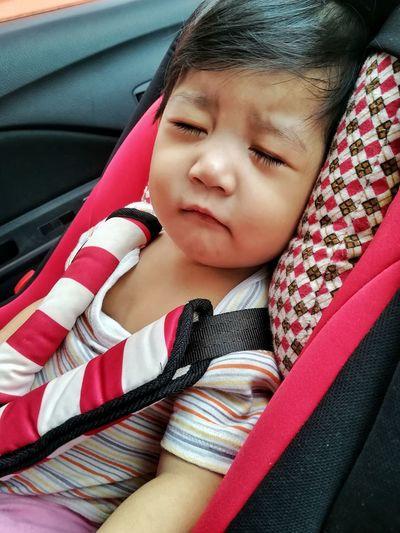 Cute baby girl sleeping in car