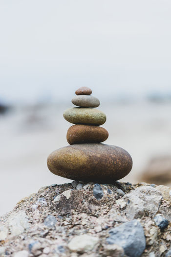 Stack of stones on the sea beach, stone balance. Stack of zen stones on beach. Pyramid of stones on the beach. Pyramid Of Stones Zen Stones Balance Beach Close-up Focus On Foreground Land Nature No People Outdoors Pebble Rock Rock - Object Sea Selective Focus Solid Stack Stack Of Stones Stone Stone - Object Tranquility Water Zen-like