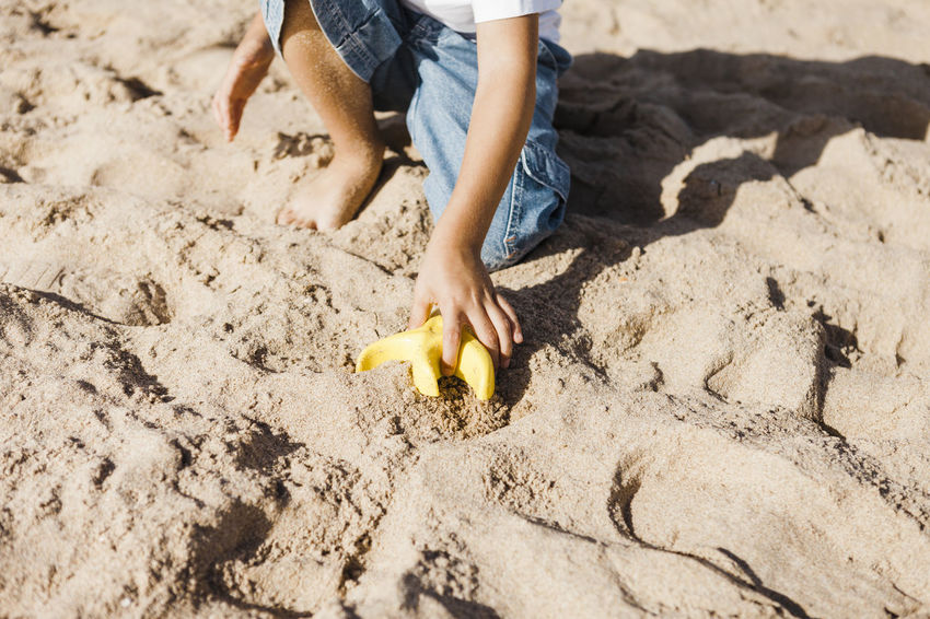 Adult barefoot Beach Child Childhood Close-up Day Digging Human Body Part Human Hand Low Section One Boy Only One Person Outdoors People Sand Sand Pail And Shovel Summer