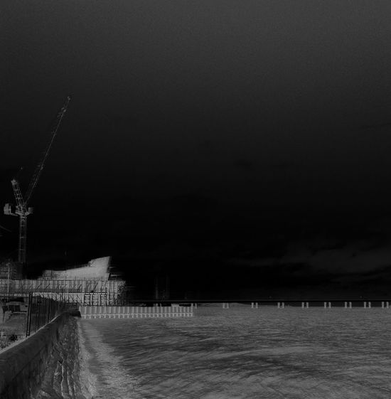 Water Nature Sea Railing Outdoors Sky Beauty In Nature Scenics No People River Riverside Dundee Construction Crane Black And White Blackandwhite Bnw Monochrome Monochrome Photography V&A Museum Under Construction...