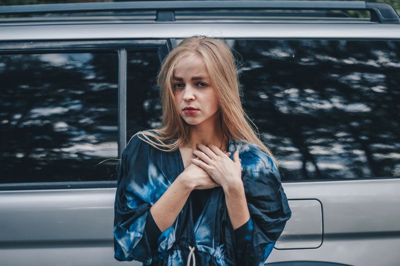 Portrait of a beautiful young woman in car