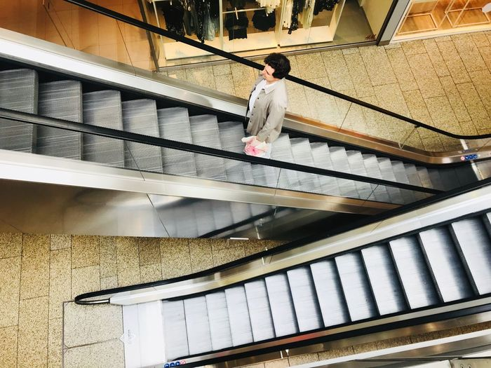 Moving still Geometric Shape Stairs Movement Grey Architecture Staircase Built Structure One Person Railing Real People Steps And Staircases Building Exterior Building The Still Life Photographer - 2018 EyeEm Awards