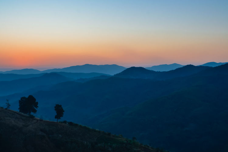 Beauty In Nature Copy Space Environment Idyllic Landscape Majestic Mountain Mountain Range Nature No People Non-urban Scene Orange Color Outdoors Remote Scenics - Nature Silhouette Sky Sunset Tranquil Scene Tranquility Tree