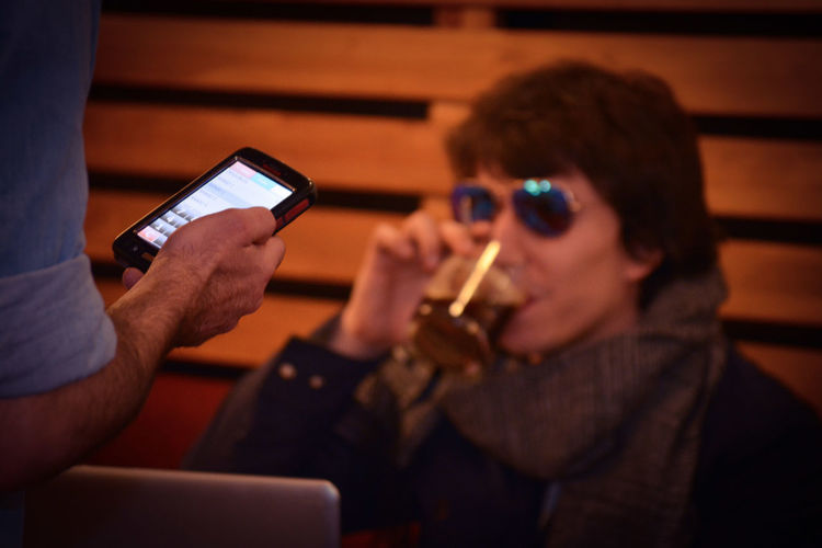Close-up of woman using mobile phone