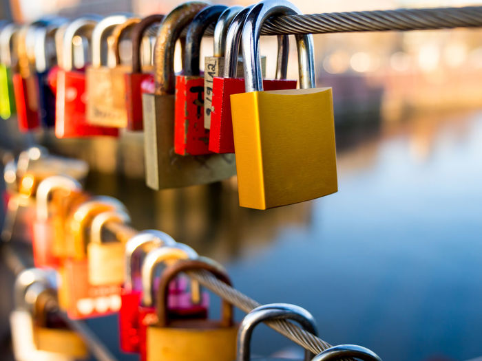 Love Locks Bridge Choice Close-up Day Detail Eternal Love Focus On Foreground Golden Hour In A Row Locks Love Love Locks Multi Colored No People Relationship River Romantic Selective Focus Side By Side Still Life Symbol Symbolic  Symbolism Warm Colors Water
