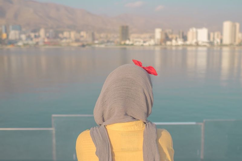 A girl with a hijab watching an artificial lake in an artificial city , tehran , iran Rear View One Person Real People Water Day Outdoors Women Focus On Foreground Leisure Activity Lifestyles Built Structure Architecture Nature Sky Close-up People City Only Women Streetphotography Love Iran EyeEm Best Shots Young Women Art Minimal