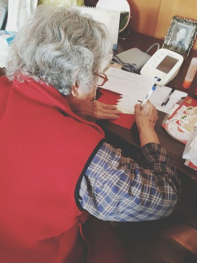 When Christmas coming..😍 Sending Christmas Cards for Family's & Friends around the world..😊 My grandma always do this every year,when she young until now she is 93 year old. Handwriting  Christmas Card All About Love The Power Of Love Love Taiwanese Grandma Oldbutawesome Older Woman Taiwan A New Perspective On Life Sitting Women Human Hand Office Paper Sketch Pad Young Women Living Room High Angle View Close-up Written Love Letter