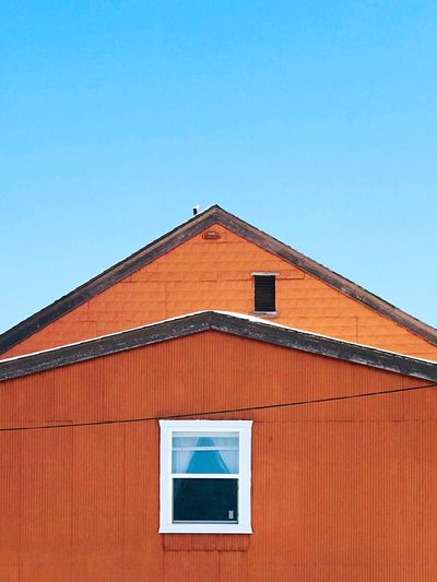 17.62° Architecture Building Exterior Built Structure Roof No People Day Clear Sky Low Angle View Window Tiled Roof  Sky Building Clear Sky Orange Color Blue Roof House Residential District Wall - Building Feature Geometric Shape Shape