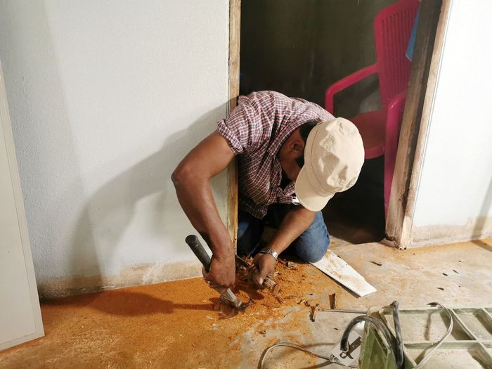 High angle view of man working at home